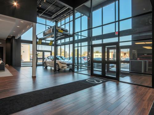 Wilkins Mazda interior showroom car lift front display