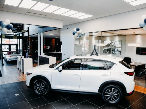 Ray Price Mazda Interior showroom with car